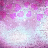 Lovely textured shiny purple heart shapes background Stock Image