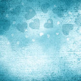 Lovely textured shiny turquoise heart shapes background Stock Images