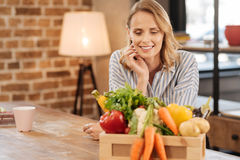 Lovely thoughtful woman deciding what to cook Royalty Free Stock Photos