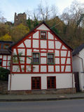 Lovely Timbered House in Altenahr. Old German house and castle ruin Altenahr royalty free stock photo