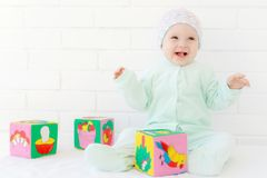 Little girl playing with colorful cubes royalty free stock image