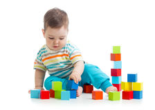 Lovely toddler baby playing with building cubes. Isolated on white. Stock Photography