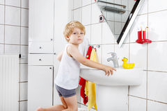 Lovely toddler boy brushing his teeth, indoors Royalty Free Stock Photos