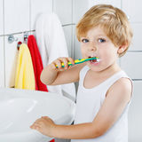Lovely toddler boy brushing his teeth, indoors Royalty Free Stock Images