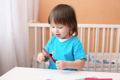 Lovely toddler boy with scissors Royalty Free Stock Photos