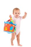 Lovely toddler holding toy in hand Stock Photo