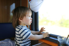 Lovely toddler out of window in the train Royalty Free Stock Photo