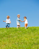 Lovely toddlers. Three lovely toddlers on the hill royalty free stock image