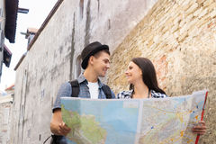 Lovely tourist couple checking the map Royalty Free Stock Photos