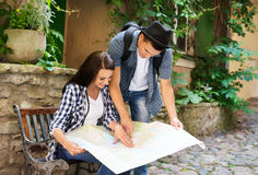 Lovely tourist couple checking the map Stock Photos