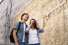 Lovely tourist couple making photos. Travelling couple having a walk on bohemian street in Europe stock photography