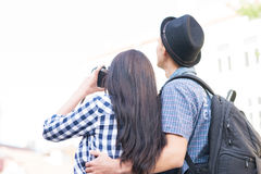 Lovely tourist couple making photos Stock Images
