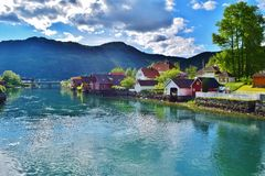 Lovely town with beautiful houses and a fjord-river. Lovely town with beautiful houses and a fjord-river in Norway Stock Photography