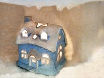 Lovely toy winter small house in snow and ice Stock Images