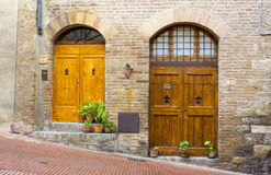 Lovely tuscan doors. San Gimignano, Italy Stock Photos