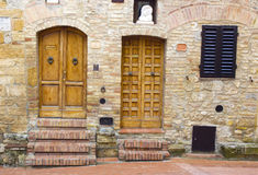Lovely tuscan doors Stock Photography