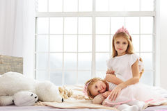 Lovely two princesses relaxing at home Royalty Free Stock Photos