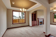 Lovely unfurnished living room with carpet. Royalty Free Stock Images