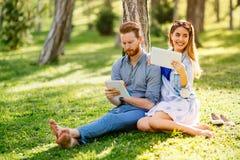 Lovely university students studying outdoors stock photo