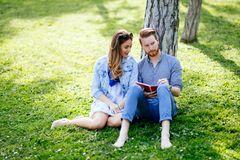 Lovely university students studying outdoors royalty free stock photo