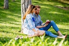 Lovely university students studying outdoors royalty free stock image