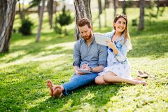 Lovely university students studying outdoors royalty free stock images