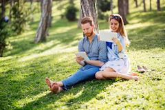 Lovely university students studying outdoors stock images