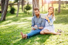 Lovely university students studying outdoors. In park Royalty Free Stock Image