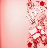 Lovely Valentines day background with word Love , gift box, hearts and decoration, top view. Place for text royalty free stock photography