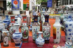 Lovely vases. A trip to Southeast Asia. The Vietnamese market. Floor vases and Souvenirs in the market in Vietnam. Selling beautiful vases. Bargaining of buyers Stock Photo