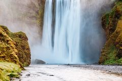 Lovely view of famous Skogafoss waterfall and scenic surrounding