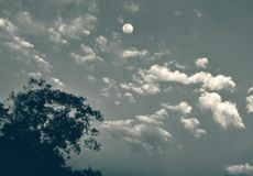 A view of moon in the clouds with an artistic touch stock photography