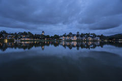 Lovely view of the lake near luxurious tropical resort over cloudy sky Stock Photography