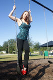Lovely, Voluptuous Brunette on a Swing (4) Royalty Free Stock Photography