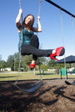 Lovely, Voluptuous Brunette on a Swing (5). A beautiful, young, busty brunette plays in a swing outdoors Stock Images