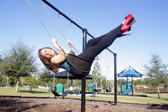 Lovely, Voluptuous Brunette on a Swing (6). A beautiful, young, busty brunette plays in a swing outdoors Stock Images
