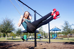 Lovely, Voluptuous Brunette on a Swing (7). A beautiful, young, busty brunette plays in a swing outdoors Stock Image