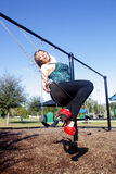 Lovely, Voluptuous Brunette on a Swing (8). A beautiful, young, busty brunette plays in a swing outdoors Stock Image