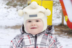 Lovely warm dressed baby age of 1 year in winter Stock Photos