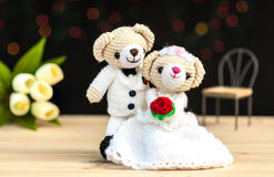 Lovely wedding bear dolls. With back background and light color bokeh Royalty Free Stock Images