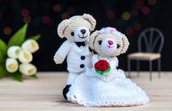 Lovely wedding bear dolls. With bokeh background Royalty Free Stock Photos