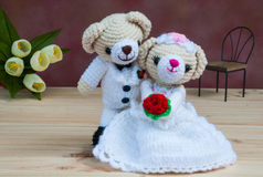 Lovely wedding bear dolls. On wooden floor royalty free stock photo