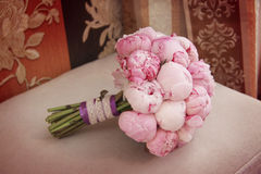 Lovely wedding bouquet on armchair Royalty Free Stock Images