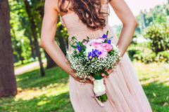 Lovely wedding bouquet and bride Royalty Free Stock Photos