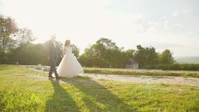 Lovely wedding couple coming to each other and embraces at castle. Slowly stock video footage