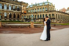 Lovely wedding couple kissing in the city royalty free stock photography
