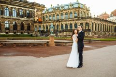 Lovely wedding couple kissing in the city royalty free stock images