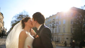 Lovely wedding couple kissing in the city shot in stock video