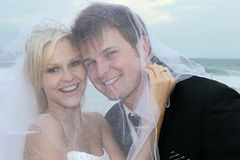 Lovely Wedding Couple at the Sea Side stock image