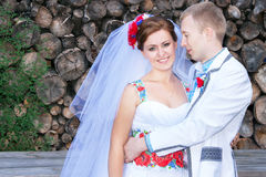 Lovely wedding couple is in the ukrainian style (dress). Royalty Free Stock Photo